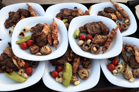 Plates with grilled meat and vegetables in the restaurant photo