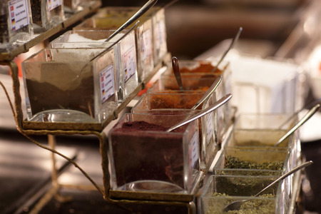 Asian spices in glass boxes at buffet photo