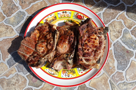 loin chops: Plate with grilled pork loin chops on a table