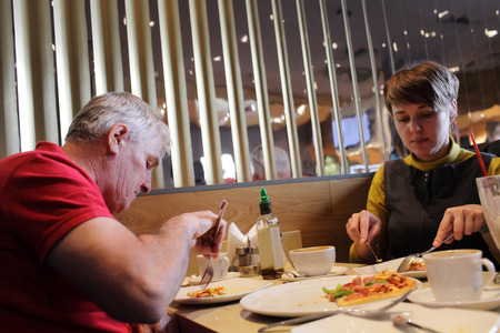 Family has lunch in the italian restaurant photo