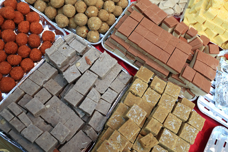 gulab: The indian sweets on the counter an market Stock Photo