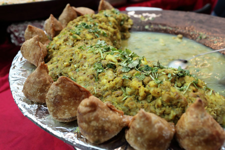 samosa: Pan with samosa potato and pea curry in the indian restaurant Stock Photo