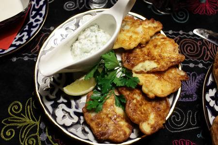 uzbek: Battered cod with sauce on a plate Stock Photo