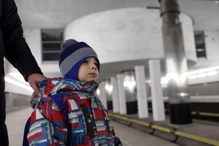 subway platform: Mother holding her son on subway platform in Moscow