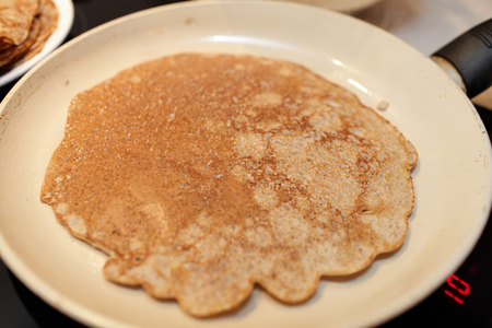 flaxseed: Pan with flaxseed meal pancake at home Stock Photo