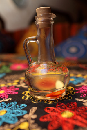 decanter: Decanter of vinegar flavored with herbs in the uzbek restaurant Stock Photo