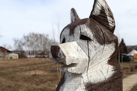 painted dog: Head of painted Husky dog, carved from wood