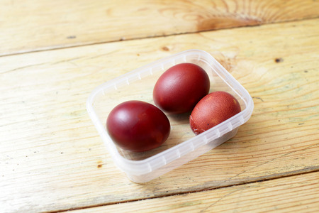 Easter eggs in the plastic container on the table photo