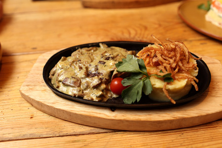 grilled pork chop: Pork chops baked with onions mushrooms and cheese