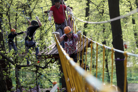 woman rope: Family climbing rope at the adventure park Stock Photo