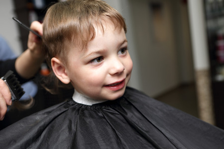 Portrait of a smiling boy at the barbershop photo