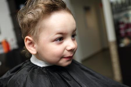 Portrait of a child at hairdresser salon photo