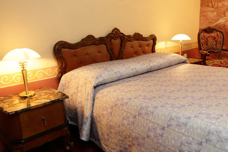 nice accommodations: Interior of a bedroom in the evening Stock Photo