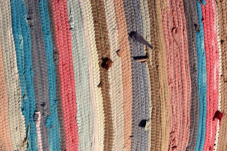 multi coloured: The striped woollen bedspread as background, Egypt