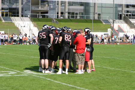 tricot: Bunch of american football players discussing the next strategy for the game Stock Photo