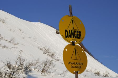 mountainside: Warning signs of avalanche danger in front of Mount Roberts (Juneau, Alaska).