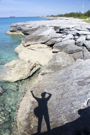 bahama: Shadow of a traveller with the eroded coastline of Grand Bahama Island  The Bahamas   Stock Photo