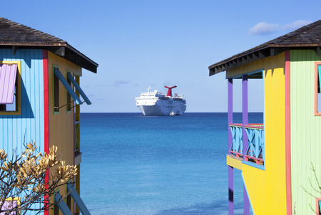 bahamian: Colorful Bahamian houses with a cruise ship in a background  Half Moon Cay
