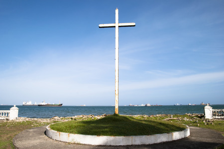 colon panama: The view of a rusty cross in Colon city - the gateway to Panama Canal
