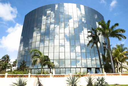 Modern building covered in glass in Belize City  Belize