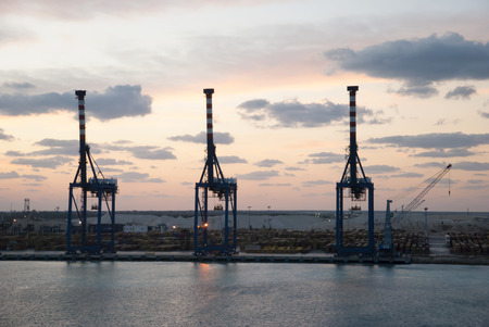 bahama: Port cranes after the sunset on Grand Bahama Island