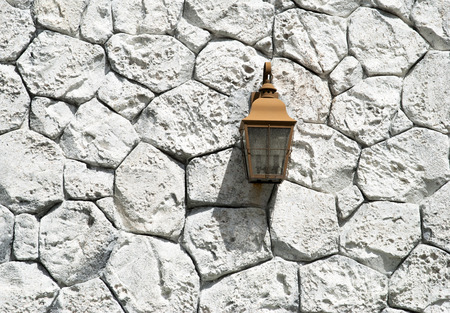 bahama: The lamp hanging on a stone wall in Our Lucaya resort town  Grand Bahama Island
