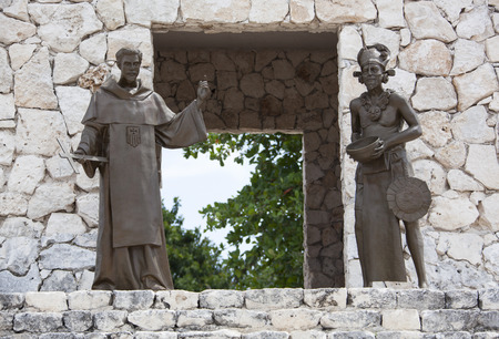 cozumel: Two sculptures representing European and native American cultures built in resort town San Miguel (Cozumel, Mexico). Stock Photo