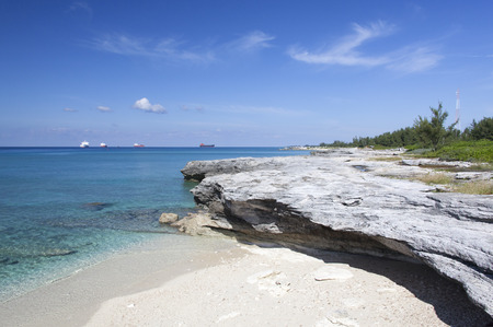freeport: The eroded beach in Freeport with cargo ships in a background (Grand Bahama Island).