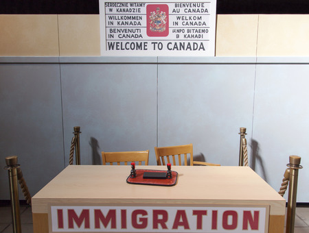 canada stamp: Welcome to Canada sign and the table of immigration (Halifax, Nova Scotia).