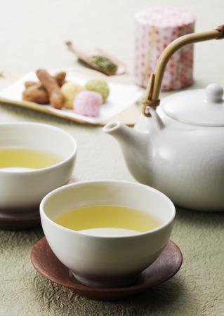 yellow tea pot: Cup of lemon tea, pot and breakfast