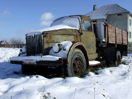 Old truck covered with snow Stock Photo