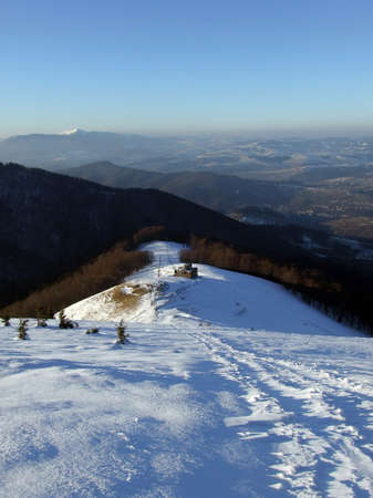 A picture of snowy Carpathian mountains in the evening photo