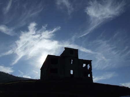 Silhouette of old ruined house Stock Photo