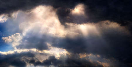 Panoramic picture of dramatic looking sky with sunrays Stock Photo