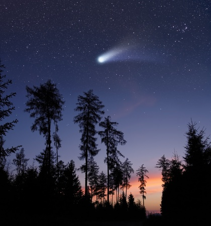 A comet in the evening sky photo