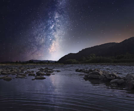 night sky and stars: Starry sky over mountain river