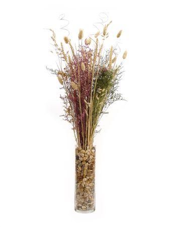 Nature floral arrangement in rock vase.
