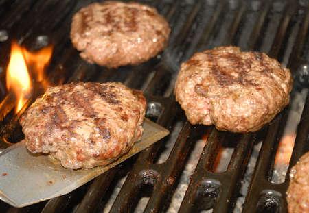 Tailgate grilling hamburger time.