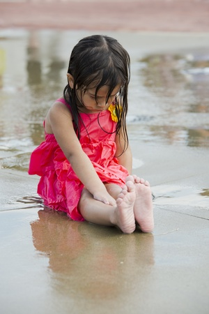 Children playing in a water park play ground in the city. Stock Photo