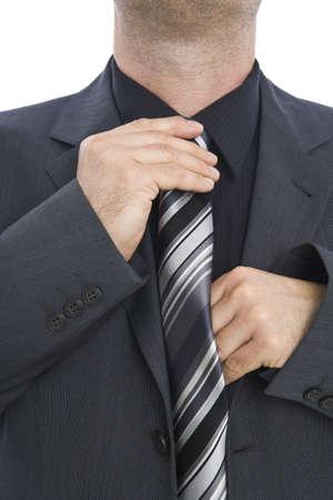 Businessman tying his necktie Stock Photo - 3331497