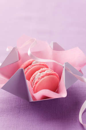 Pink macarons in gift box with ribbon. No one is viewable in the image Stock Photo - 8454304