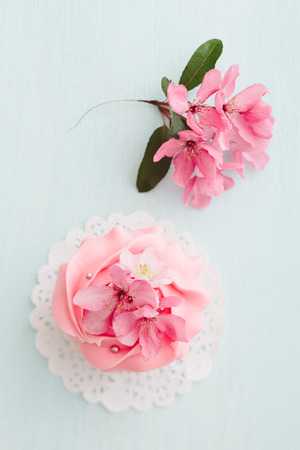 doilies: Pink buttercream cupcake and cherry blossoms