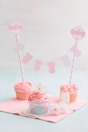 Butter cream cupcakes and cookie for a baby shower photo