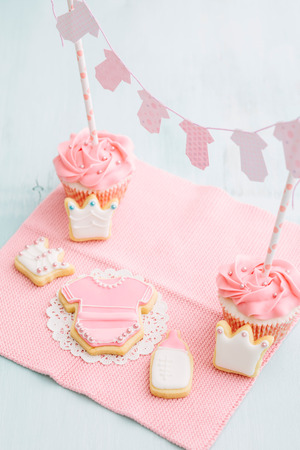 Butter cream cupcakes and cookies for a baby shower photo