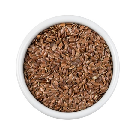 flax seed: Flax seed in a white bowl isolated on white with clipping path