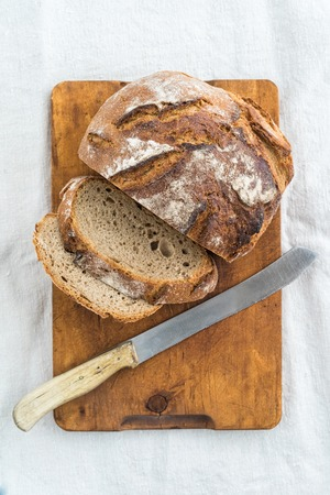 whole food: Rustic sourdough bread and knife