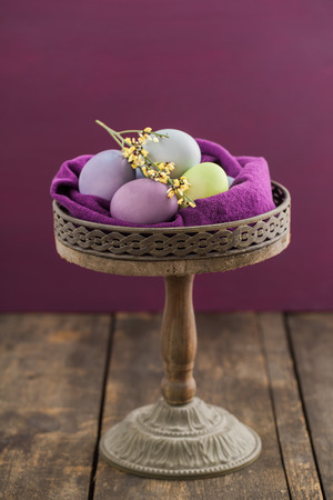 cake stand: Easter eggs on rustic wooden cake stand Stock Photo