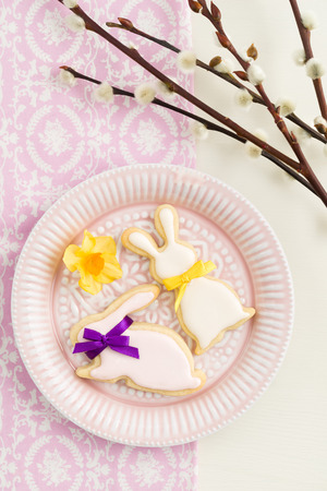pussy yellow: Easter bunny sugar cookies on a plate with pussy willow