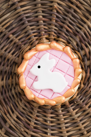 sugar cookie: Round sugar cookie with a white Easter bunny made of fondant
