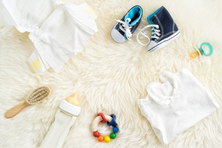 header image: Collection of items for babies shot from above. Ideal website hero or header image